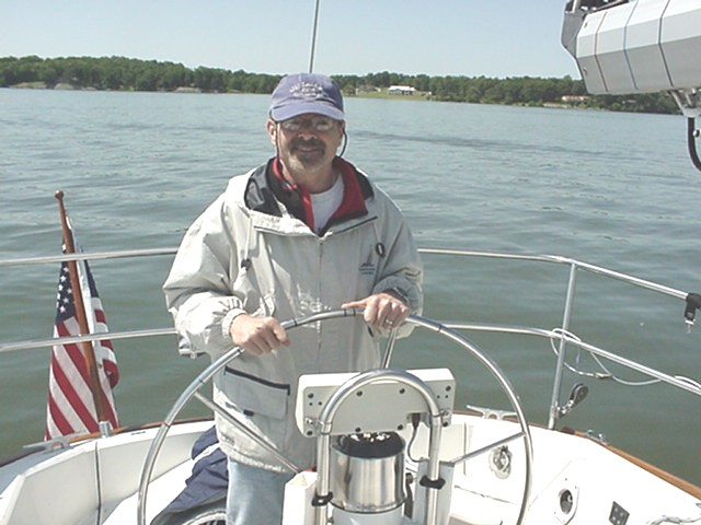 Dr. Tom Rivers at the helm